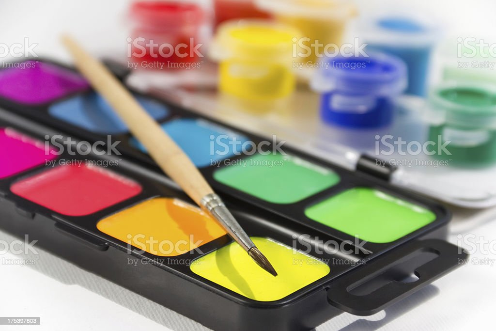 watercolor paint in containers and a brush royalty-free stock photo
