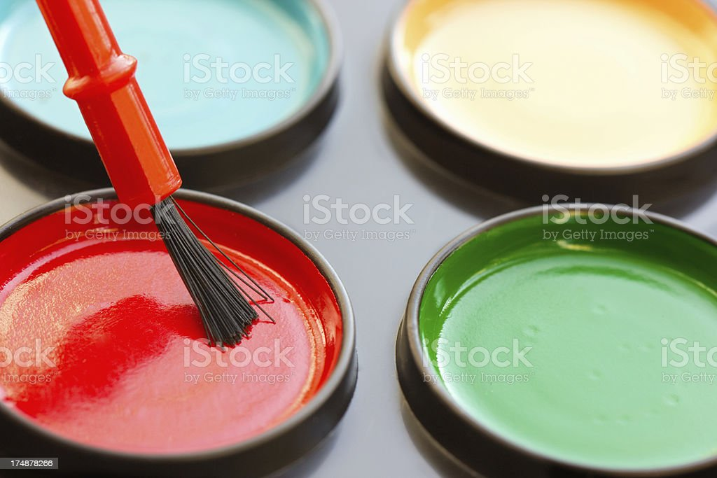 watercolor paint in containers with red brush royalty-free stock photo