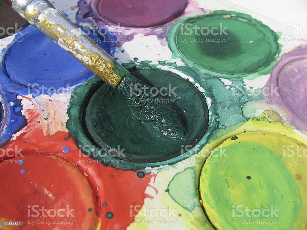 Watercolor paints and brush closeup royalty-free stock photo