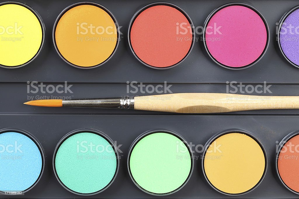 Watercolor paints and paintbrush stock photo