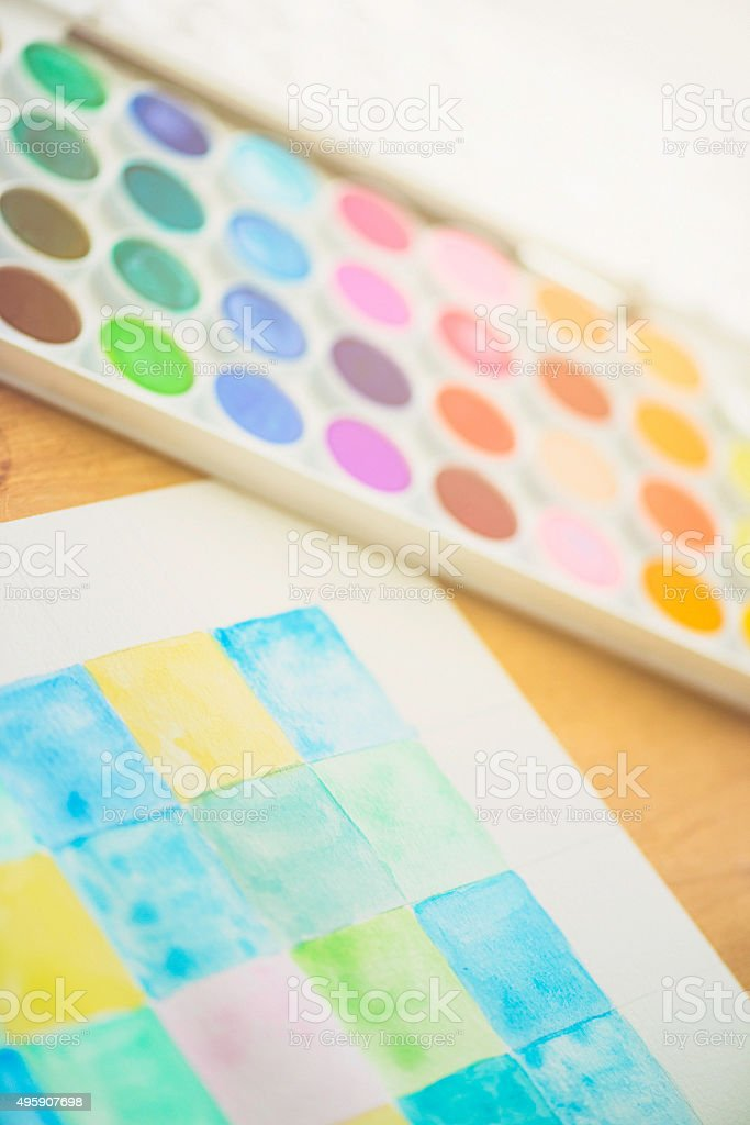 Watercolor paints and watercolor painting stock photo