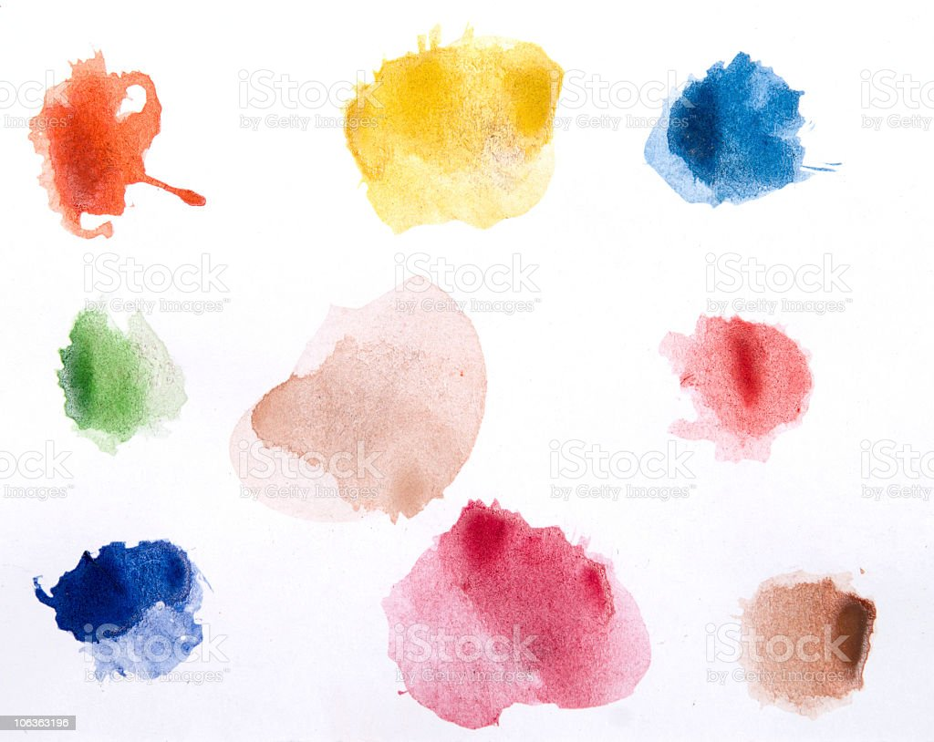 Watercolor paints on a white piece of paper ready to use stock photo