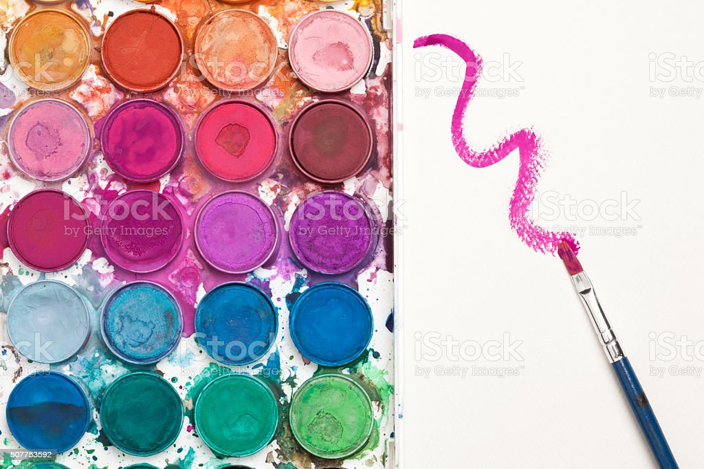 Watercolor Paints With Brush Painting On Paper stock photo