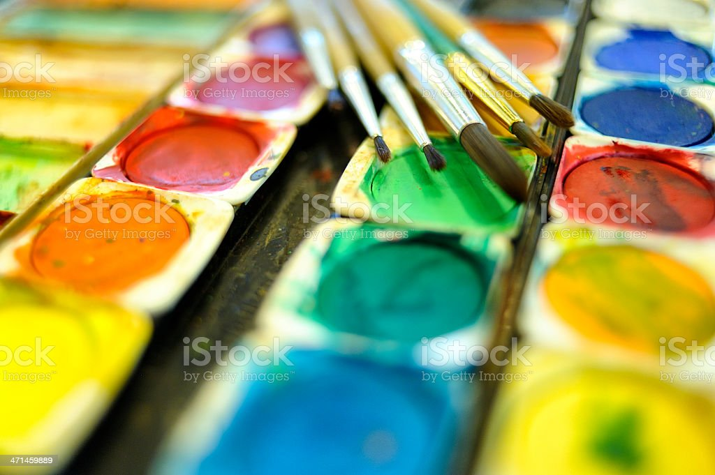 Watercolor palette and paintbrush royalty-free stock photo