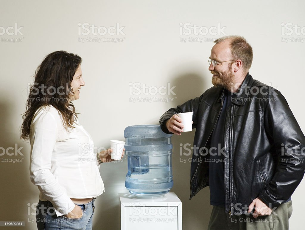 Water-cooler chat stock photo