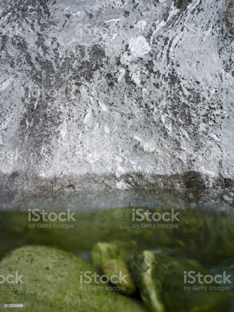 Watercourse brown reflexion stones stock photo