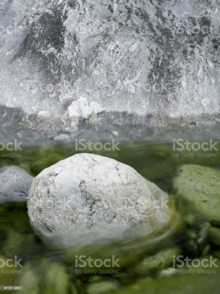 Watercourse brown stones reflexion stock photo