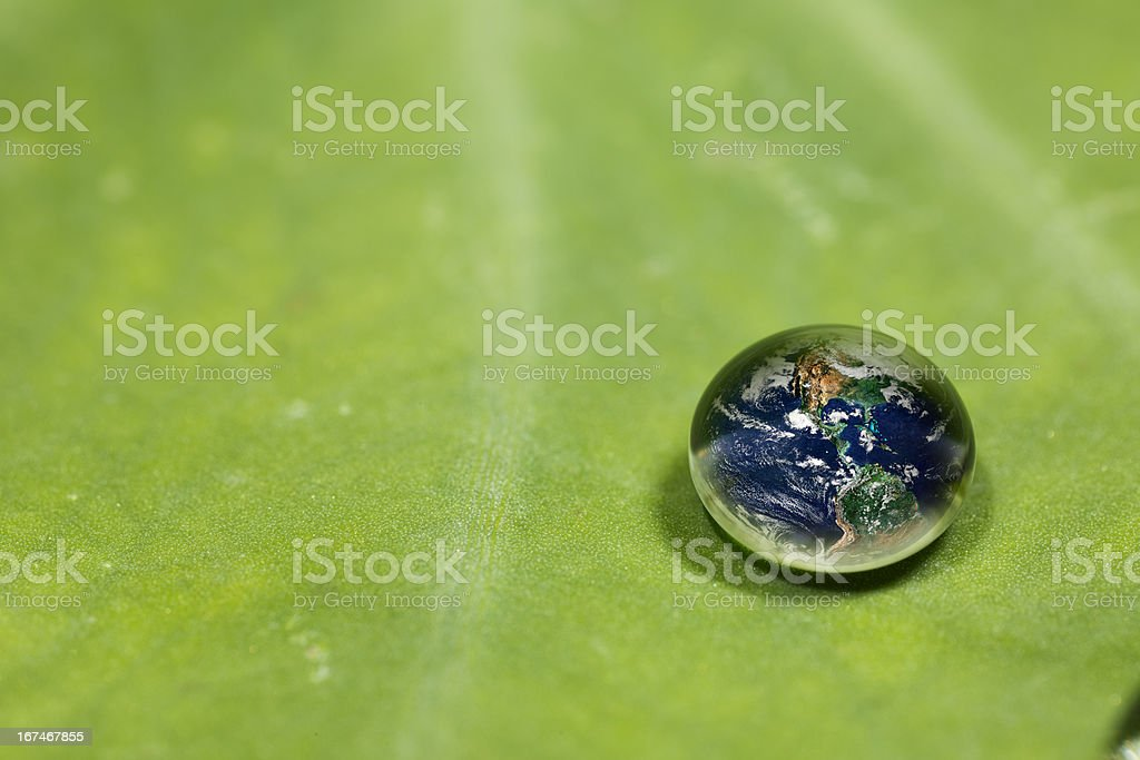 Waterdrop on a leaf reflecting earth concept royalty-free stock photo