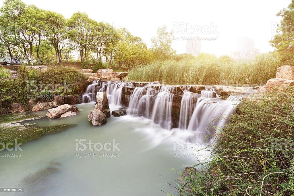 waterfall among forest stock photo