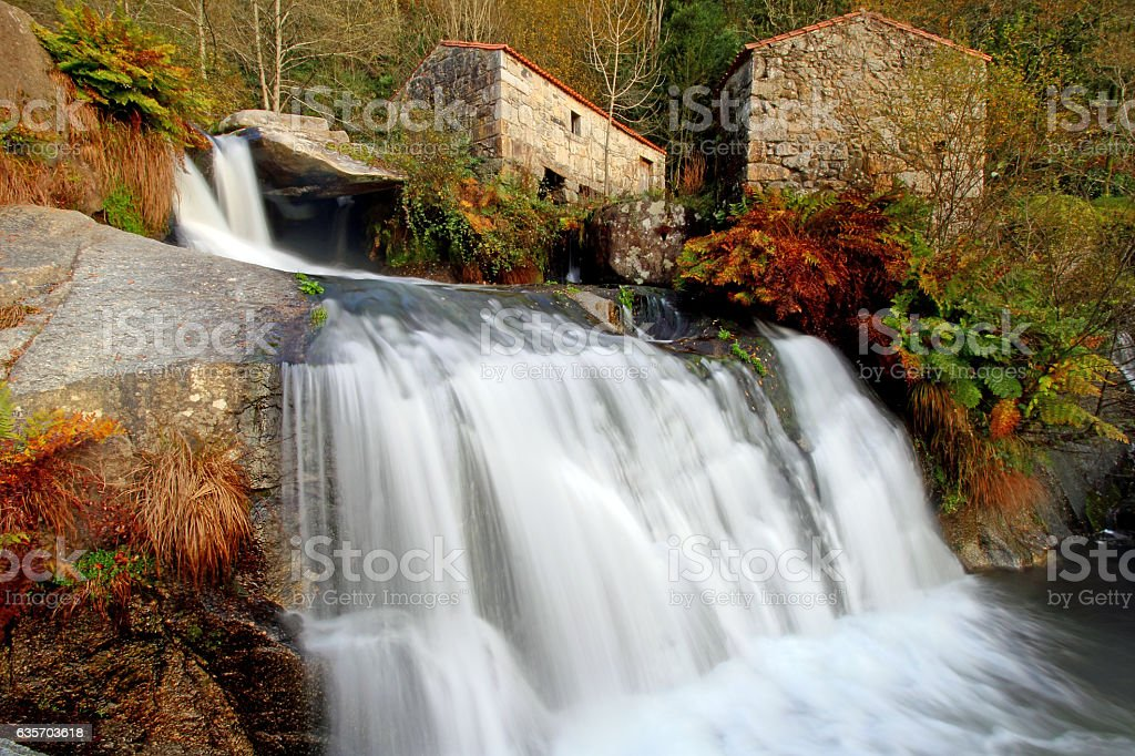 Waterfall and ancien watermills stock photo