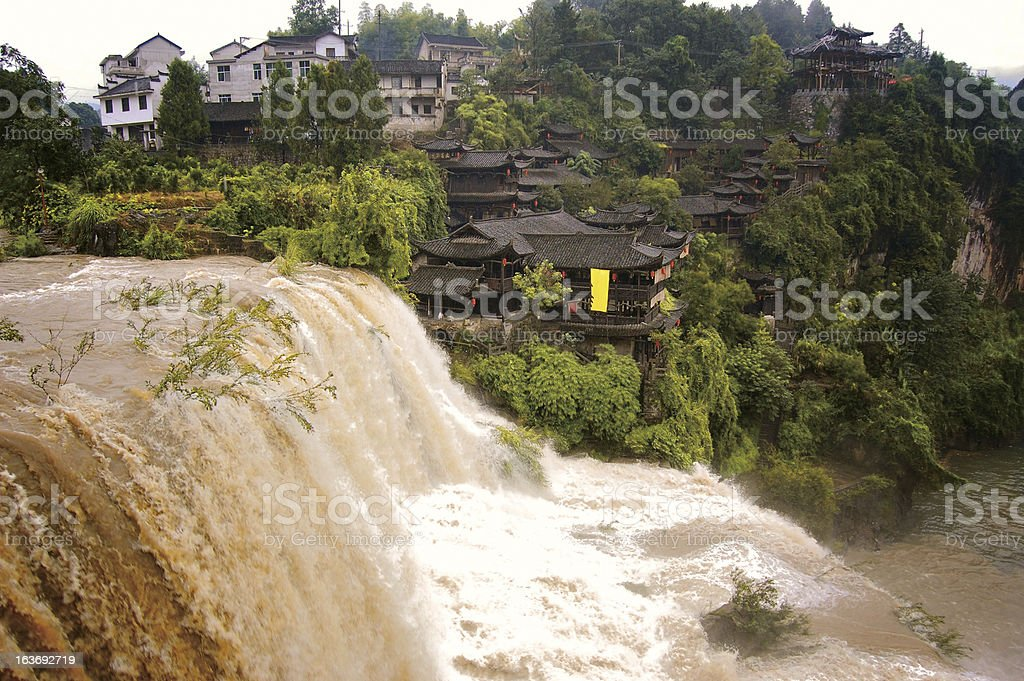 Waterfall and China traditional houses royalty-free stock photo