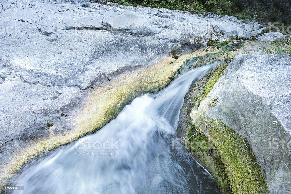 Waterfall and moss on limestone stock photo