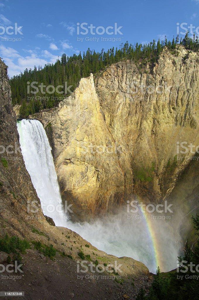 Waterfall and rainbow stock photo
