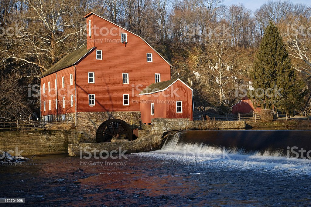 Waterfall and Red Mill stock photo