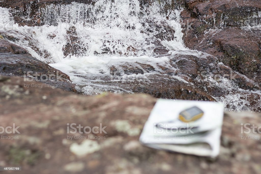 Waterfall and travel equipment royalty-free stock photo