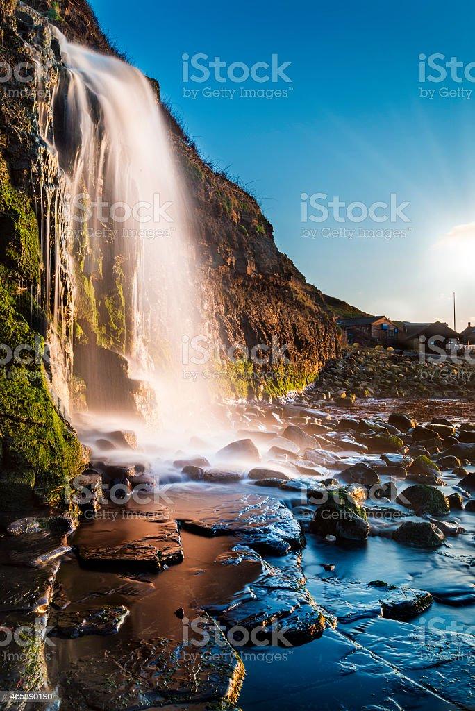 Waterfall at Kimmeridge Bay in Dorset stock photo