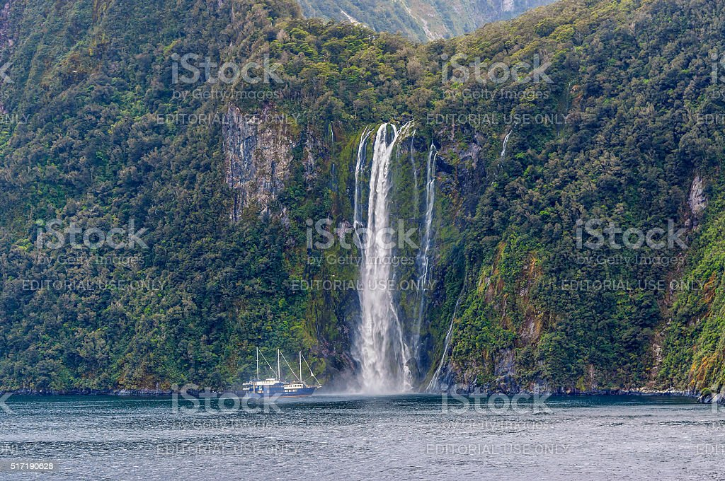 Waterfall at Milford Sound Fjord , South Island, New Zealand stock photo