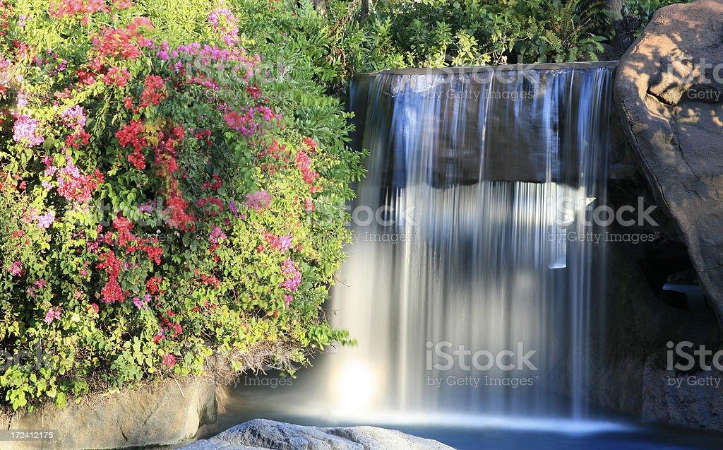Waterfall at resort stock photo
