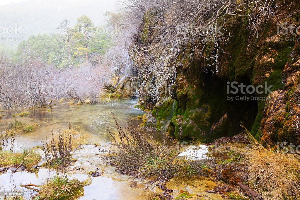 waterfall at river Cuervo in winter stock photo