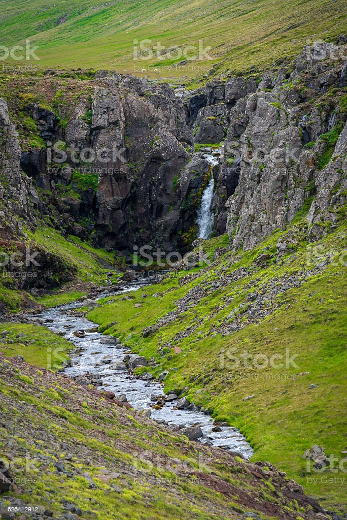 Waterfall at the Akrafjall mountain in Iceland stock photo