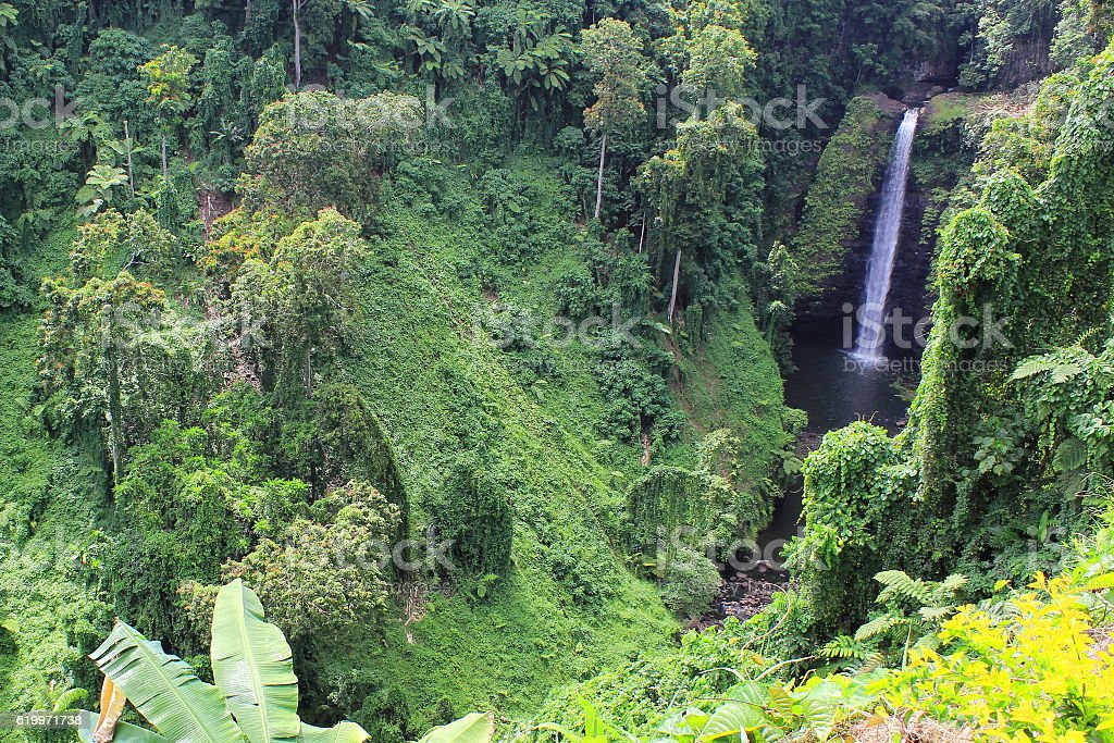 Waterfall at the end of a Valley in Western Samoa stock photo
