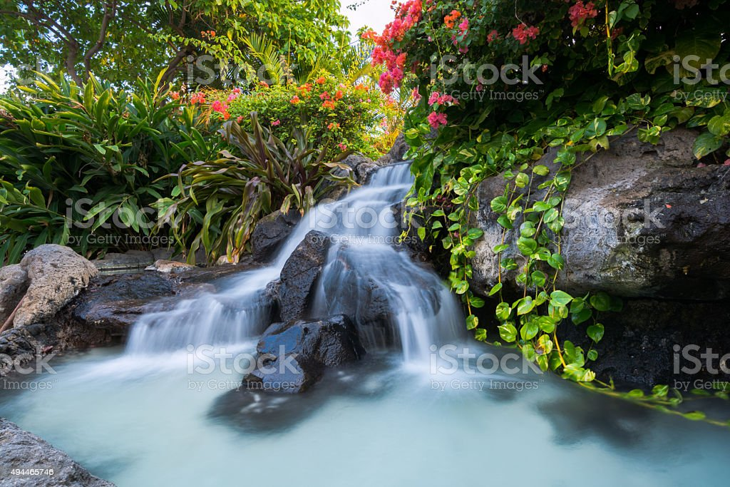 Waterfall at Waikiki Beach along Kalakaua Avenue in Honolulu, HI. stock photo