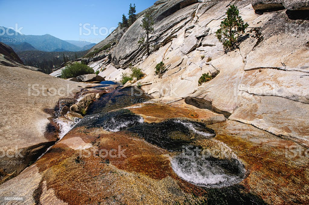 Waterfall beginning up in the mountains stock photo
