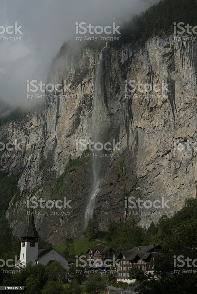 Waterfall Behind Village in the Alps royalty-free stock photo