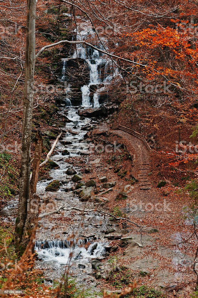 Waterfall Borzhava under the mountain village Pylypets ski resor stock photo