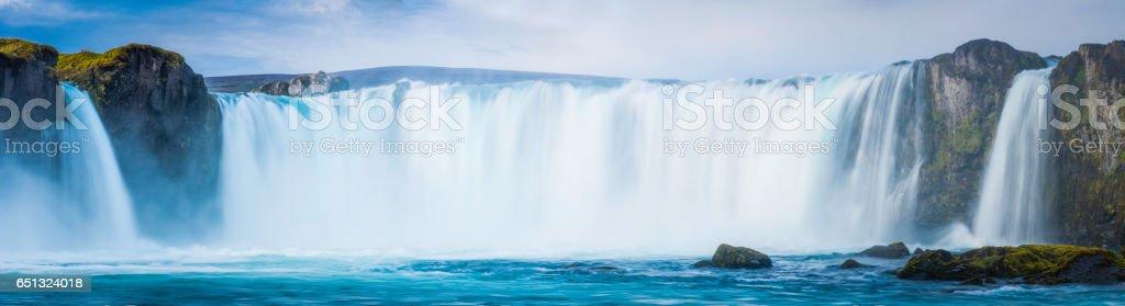 Waterfall cascading over canyon river panorama Godafoss Iceland stock photo