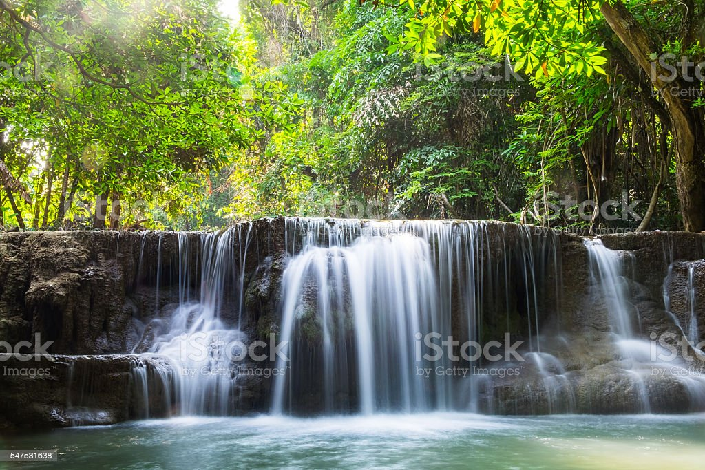 Waterfall deep forest scenic natural sunlight at huai mae khamin stock photo