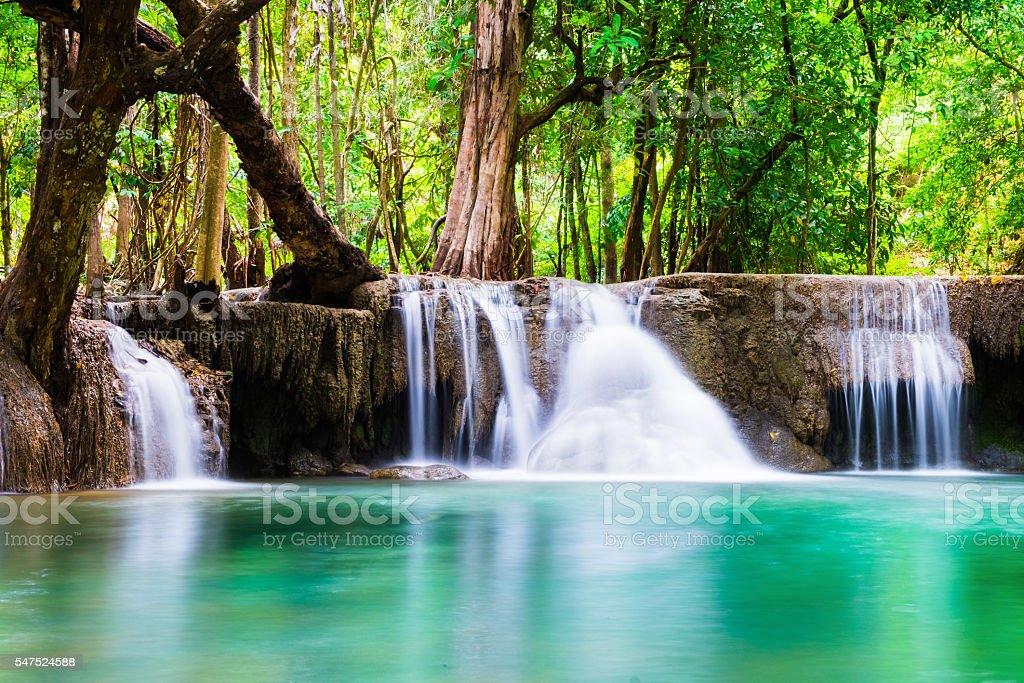 Waterfall deep forest soft scenic natural at huai mae khamin stock photo