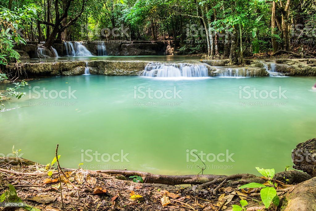 Waterfall deep forest with timber scene at huai mae khamin stock photo