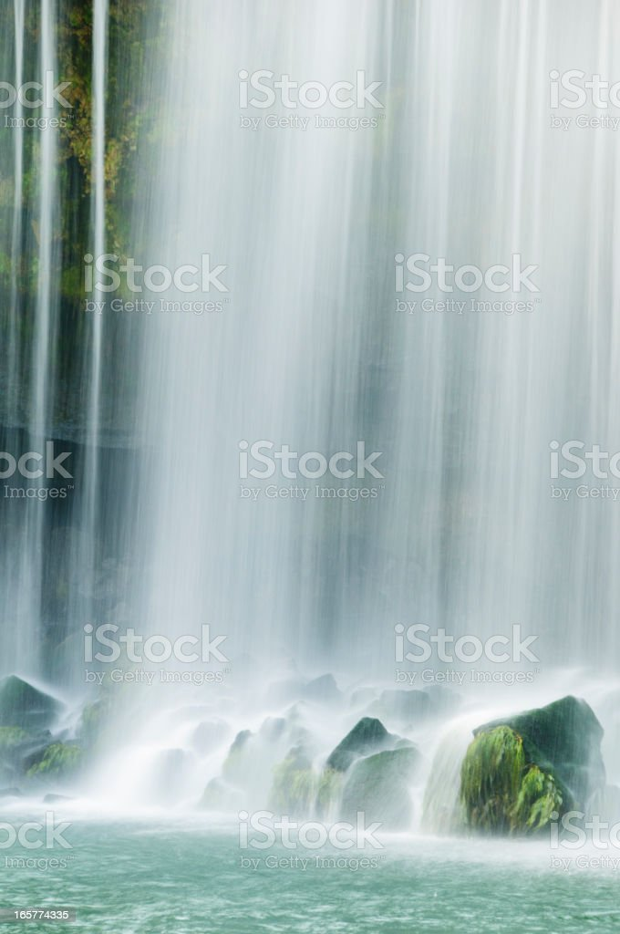 Waterfall falling on moss covered rocks royalty-free stock photo