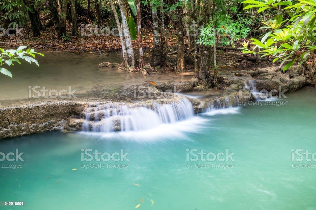 Waterfall flowing on tropical rainforest at huai mae khamin national park stock photo