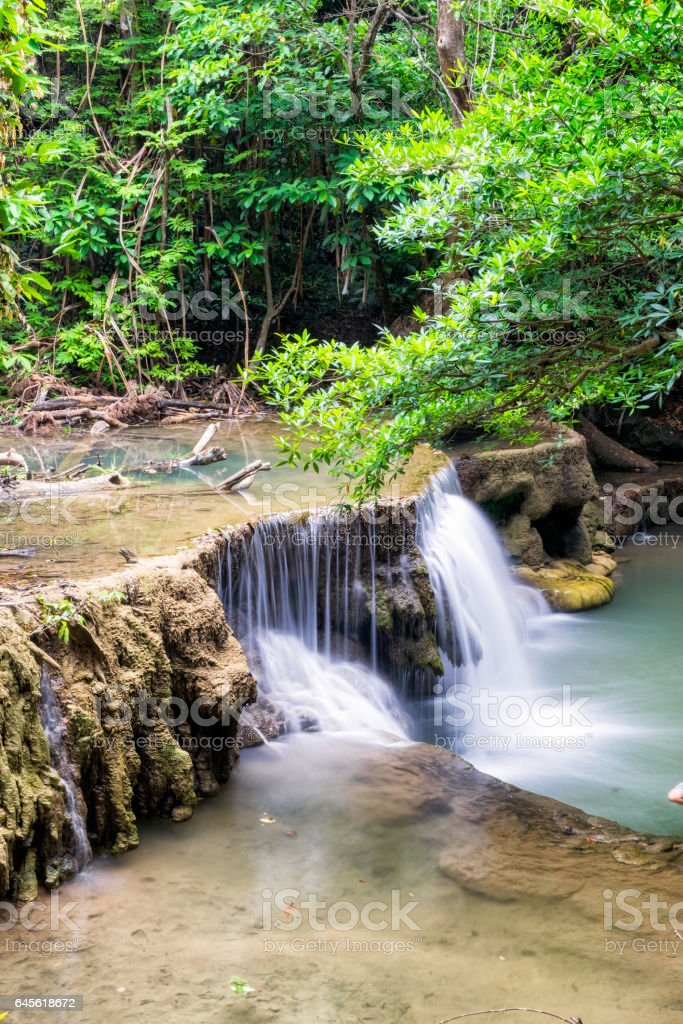 Waterfall flowing on tropical rainforest stock photo