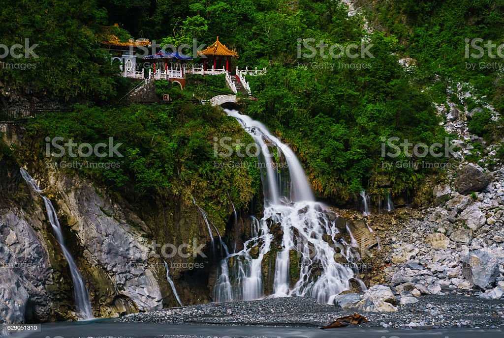 Waterfall from a cliff side temple stock photo