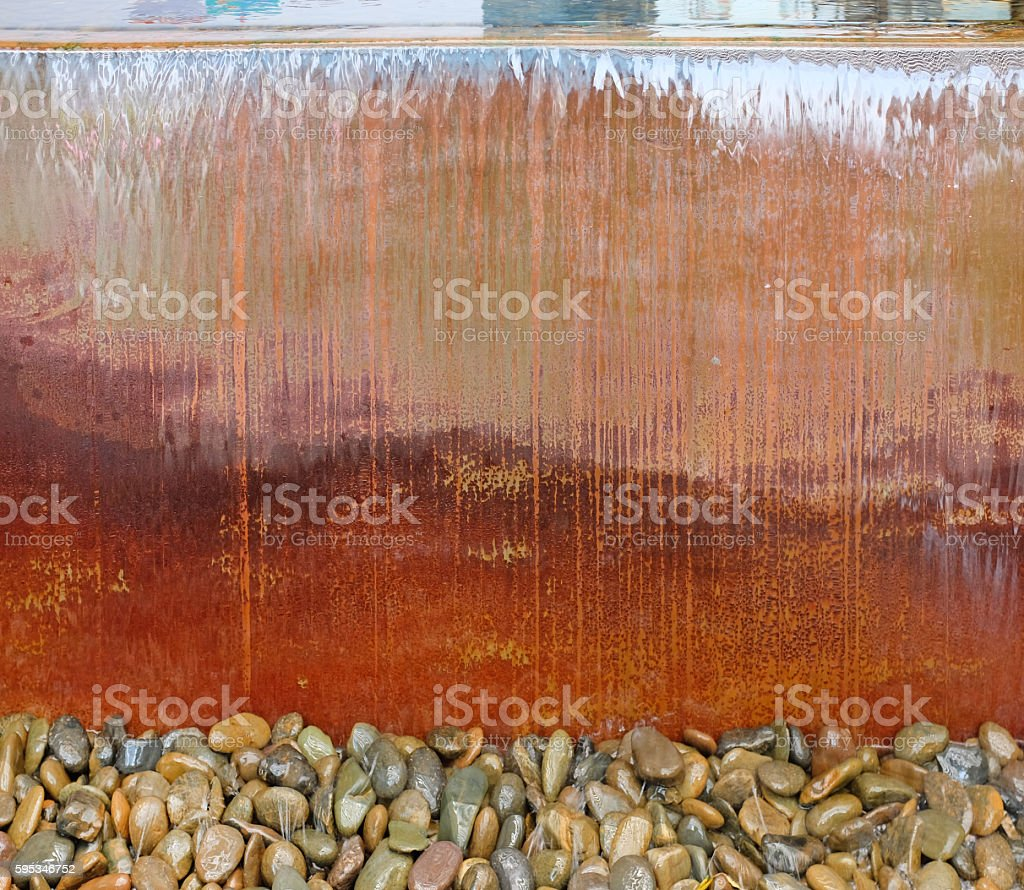 Waterfall from a fountain cascading over cement sink stock photo