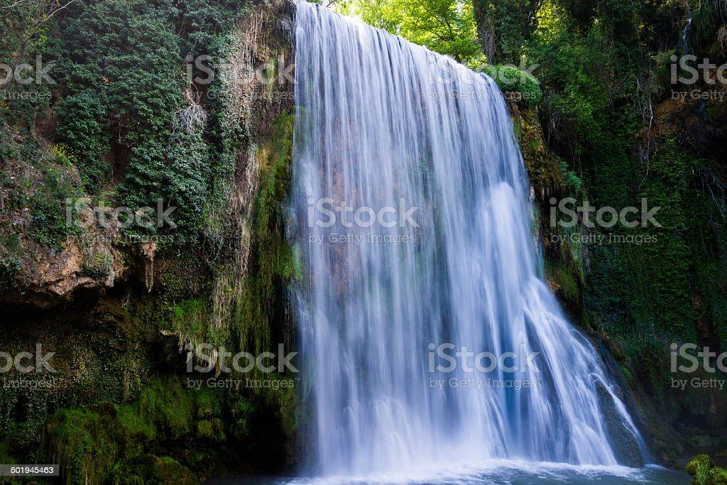 Waterfall from stone monastery, Zaragoza, Spain. stock photo