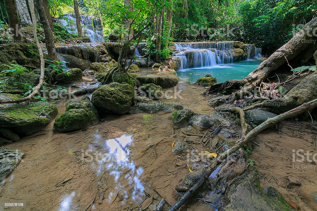 Waterfall in a deep forest stock photo