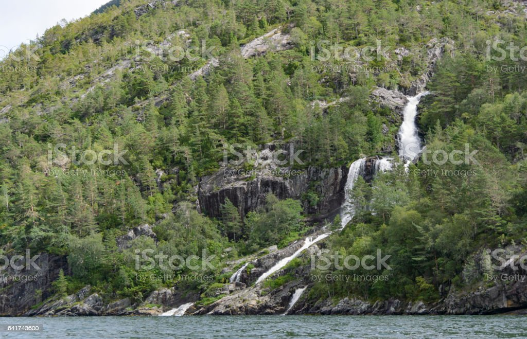 Waterfall in a Fjord in Norway during summer stock photo