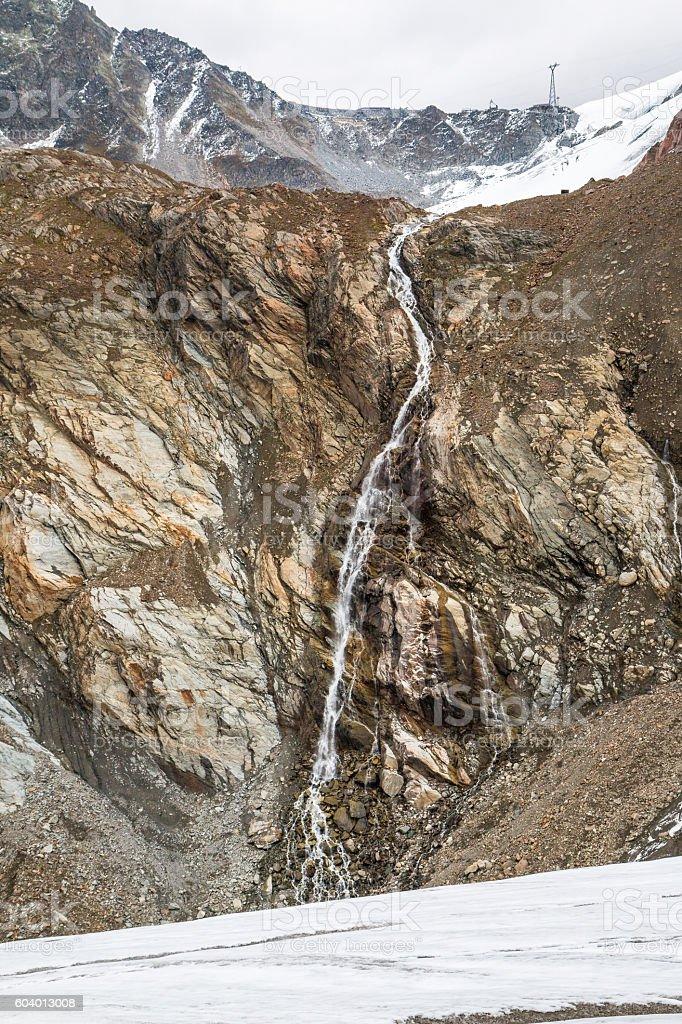 Waterfall in Austria mountains near glacier stock photo