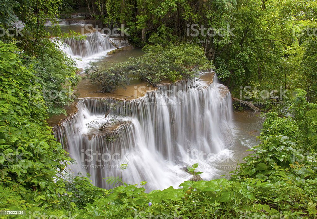 Waterfall in deep rain forest jungle royalty-free stock photo