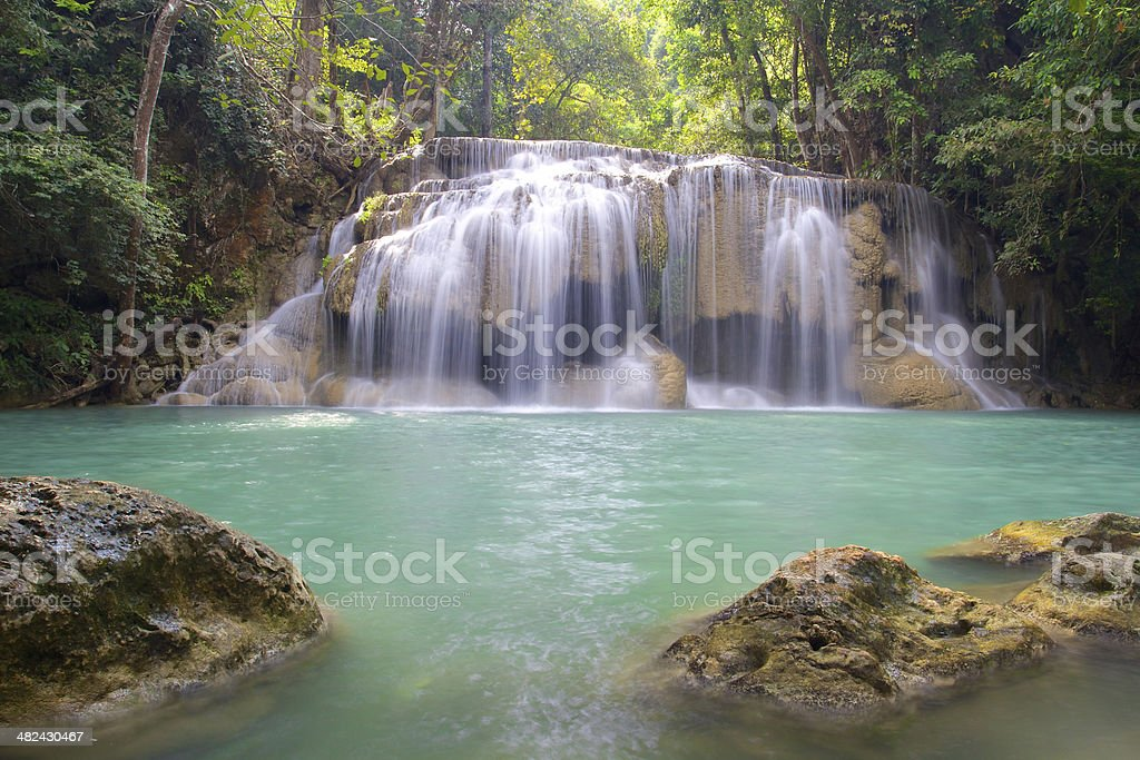 Waterfall in Erawan National Park with rocks royalty-free stock photo