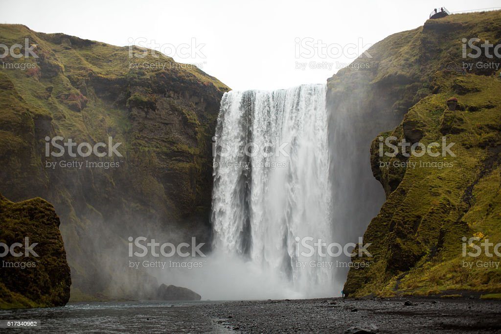 Waterfall in Iceland and green hills stock photo