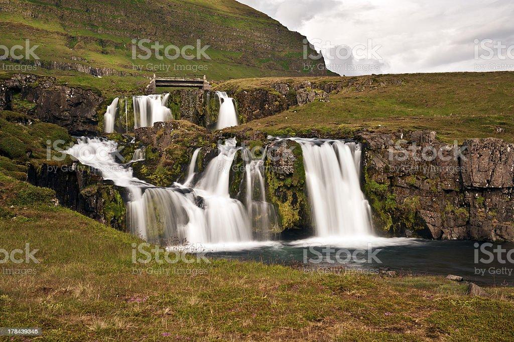 Waterfall In Icelandic Landscape stock photo