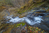 Waterfall in late autumn, Sakhalin Island, Russia.