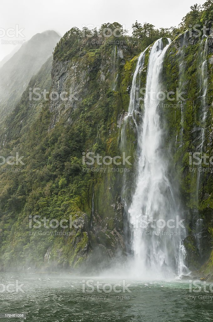 Waterfall In Milford Sound royalty-free stock photo