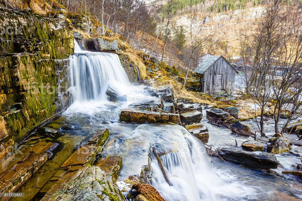 Waterfall in Norway flowing over rocks stock photo