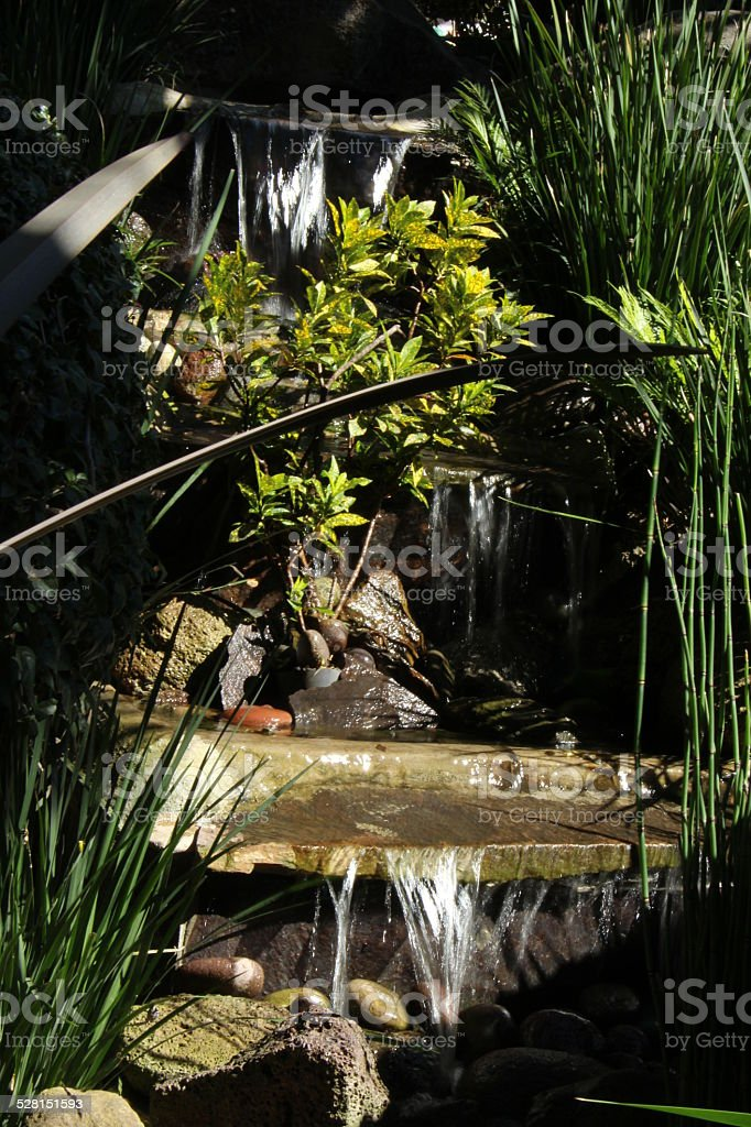 Waterfall in our garden stock photo